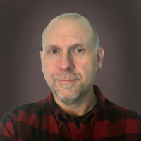 jwhedon-headshot-2021-red-gray